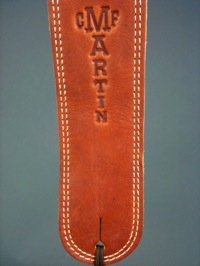 2.5 inch Martin brown ball glove leather guitar strap embossed with Martin Guitar logo